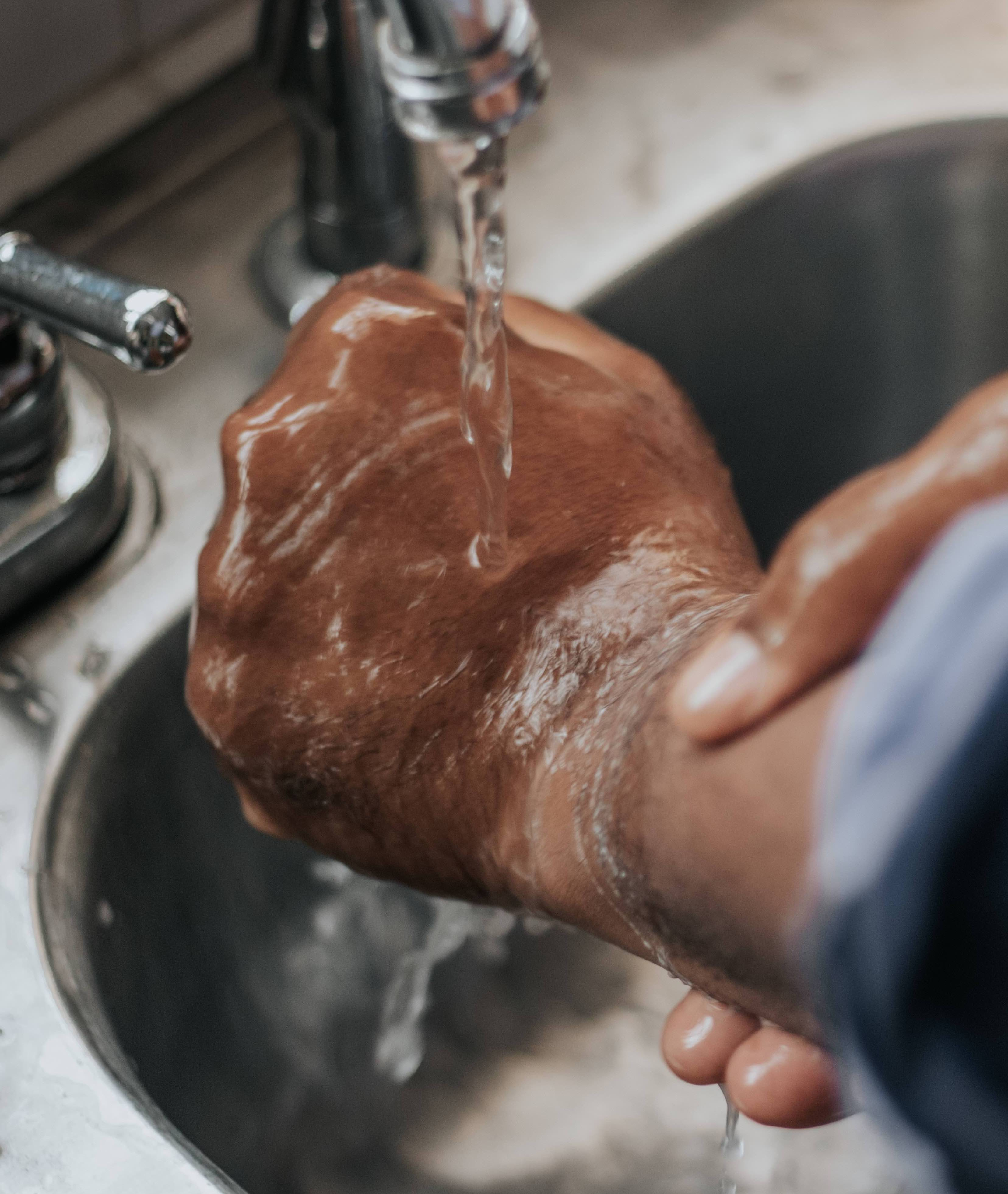 Step1: Wet and Add Soap Wet your hands with warm/cold water. Hot water is not needed - soap will get rid of the virus. Add soap to cover all over both your hands.